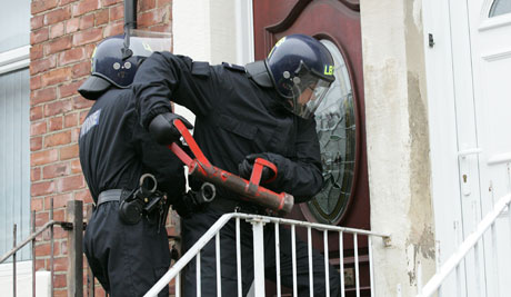 police-use-a-battering-ram-in-operation-