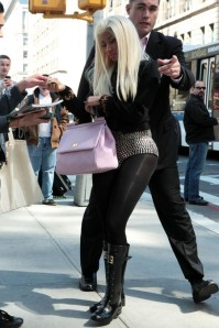 Minaj signs a few autographs before being whisked away by the LAPD.